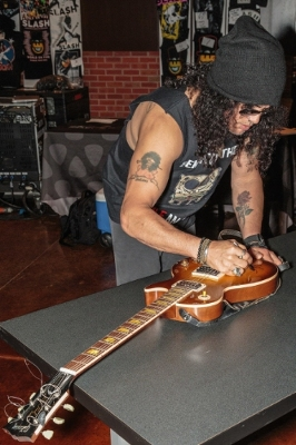 On May 19th, 2015, Grammy award winning artist SLASH signs the Gibson Les Paul '58 Reissue guitar on display at Hard Rock Hotel & Casino Sioux City. PHOTO CREDIT: Matt Downing.