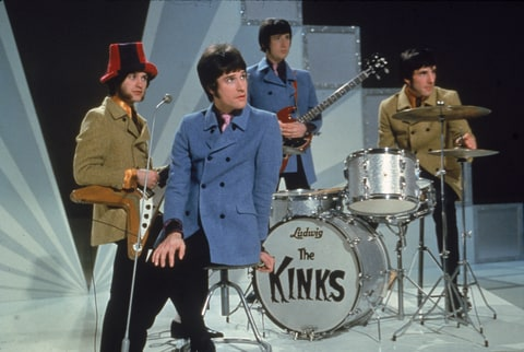 The Kinks, (L-R) Dave Davies, Ray Davies, Peter Quaife, and Mick Avory, wait on the set of a television show, ready to perform, 1968.