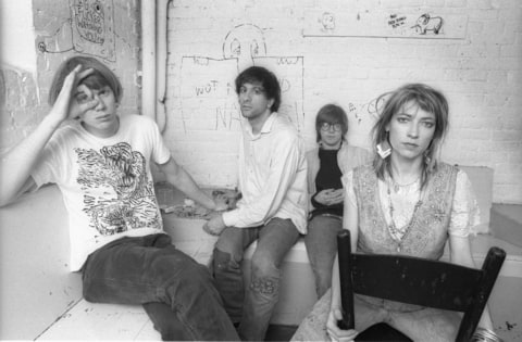 A group portrait of American rock band Sonic Youth, (L-R) Thurston Moore, Lee Ranaldo, Steve Shelley and Kim Gordon, posing backstage at Paradiso on May 11 1986 in Amsterdam, Netherlands.