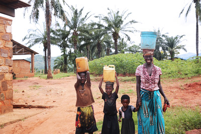 A family in Burundi, East Africa, after gathering water.  Burundi is in the midst of a water crisis.