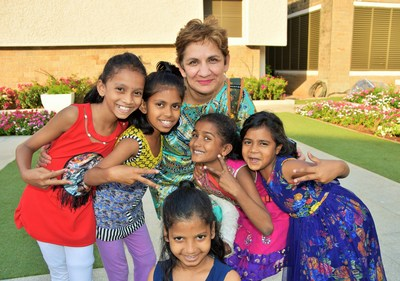 Classical Movements Founder and President Neeta Helms poses with children from Songbound in Mumbai, India